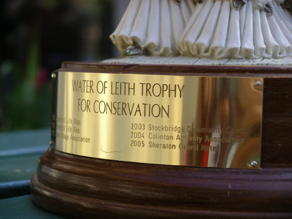 The trophy inscription.